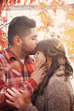 An engaged couple lovingly kiss in the fall. | My Snohomish Wedding | Wedding planning near Seattle, WA.
