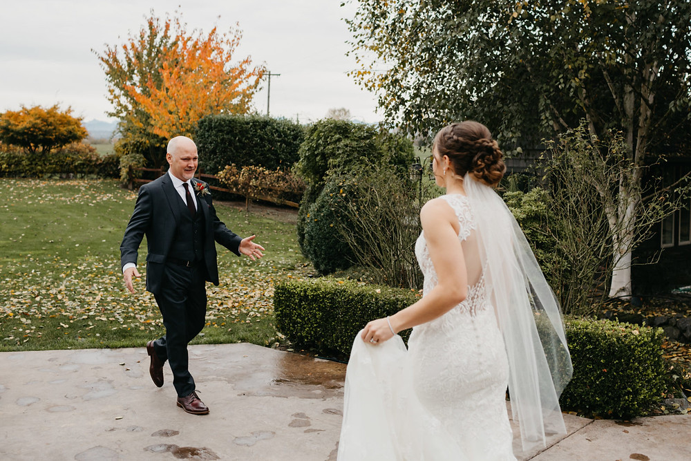 A father sneaks a first look before his daughter's romantic, stormy wedding at Hidden Meadows in Snohomish, a wedding venue near Seattle, WA. | My Snohomish Wedding | Snohomish Wedding Planning