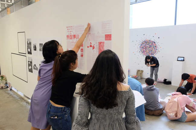 Students installing their exhibition