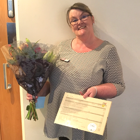 Certificate and Flowers