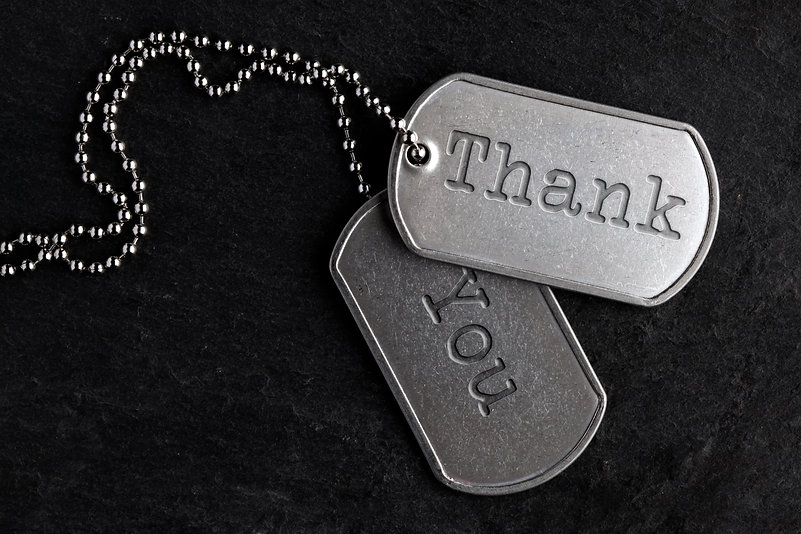 Old and worn military dog tags - Thank Y