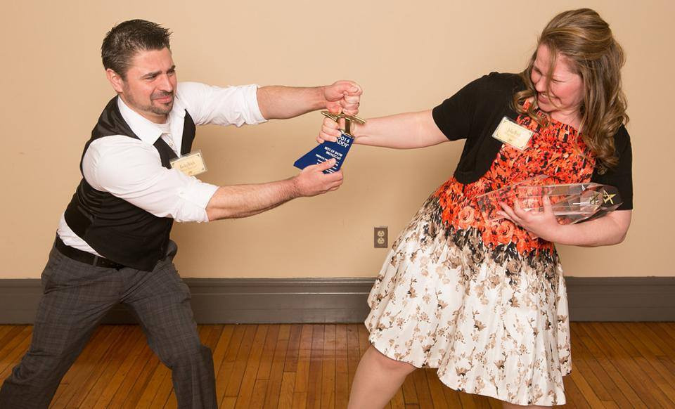 Rocky Urich & Julia Urich fighting over the right to carry home the 2014 Best Of Show Award.