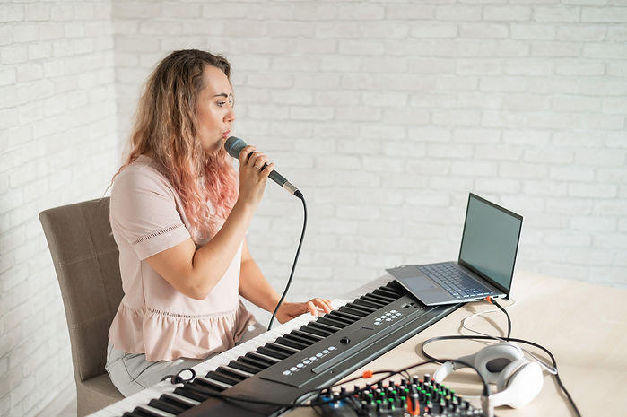 A woman records a vocal lesson using a l