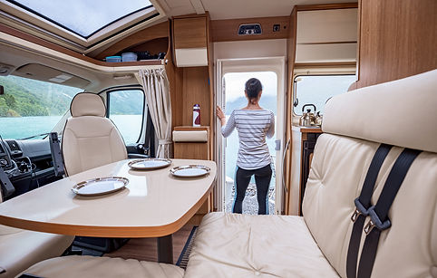 Woman in the interior of a camper RV mot