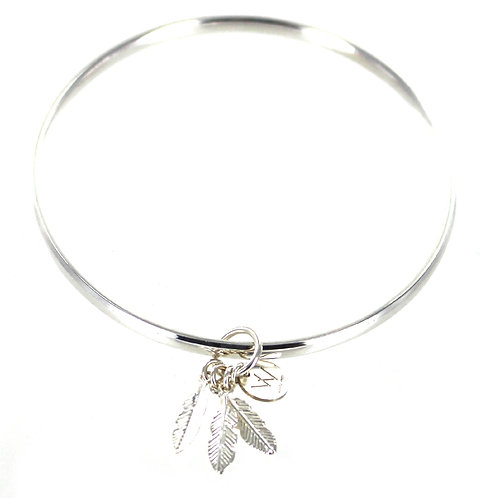 Sterling silver bangle with feather charms