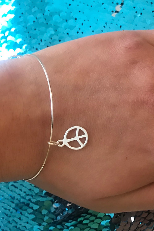 Beautiful delicate sterling silver wire bracelet with peace sign charm