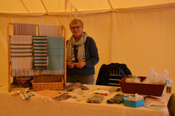 Amanda Petrie with her handwoven scarves at the Craft Market