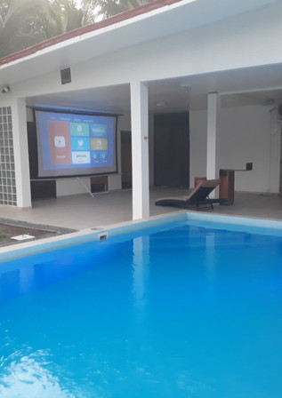 Outside SMART projector and screen for movie nights!