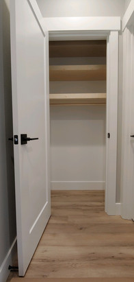 Closet with Custom Floating Shelves