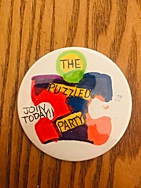 The Puzzled Party Badge!