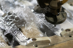 Water jet cutting in action.