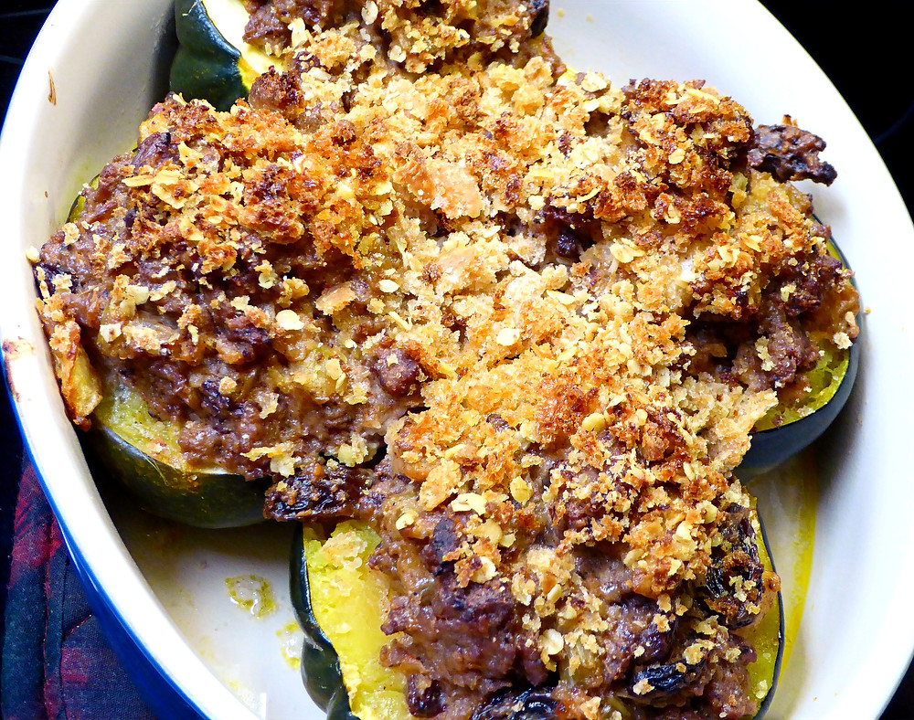 Stuffed acorn squash with turkey sausage, apples, onions, celery, dried cranberries or raisins