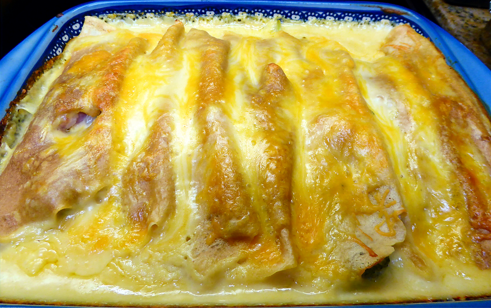 Savory Sourdough Crepes Filled With Ham , Broccoli,  Cheese and Covered With Cheese Sauce