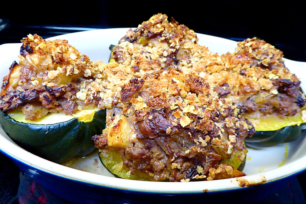Turkey sausage stuffed acorn squash with apples, onions, celery, dried cranberries