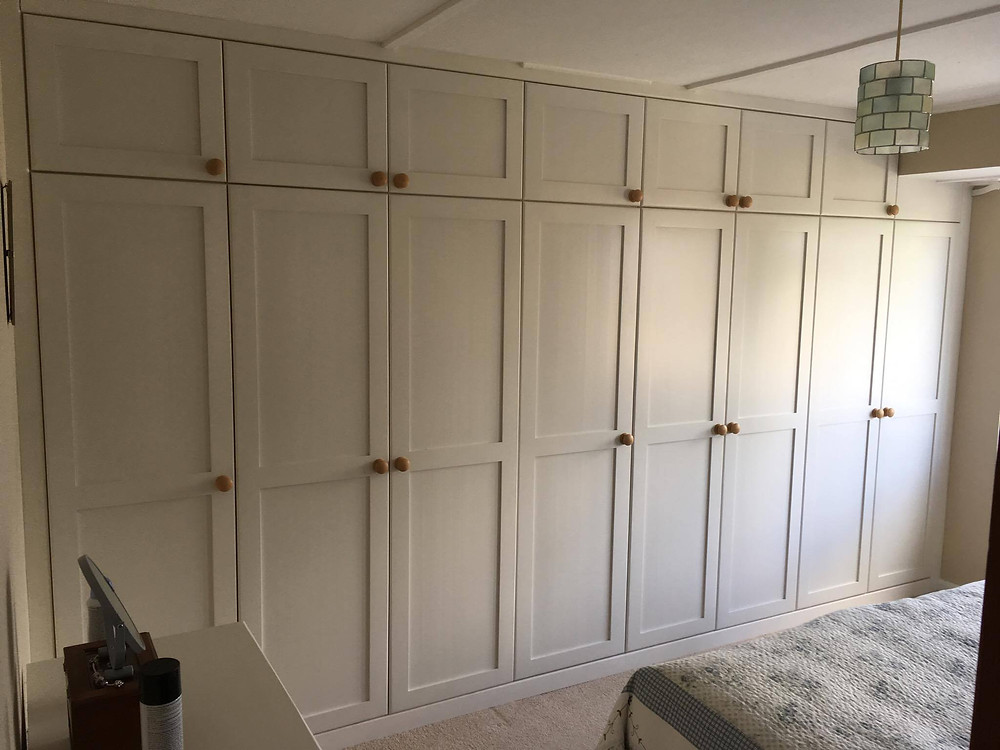 fitted wardrobe with top boxes