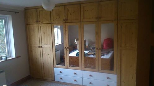 A pine fitted wardrobe with a touch of paint