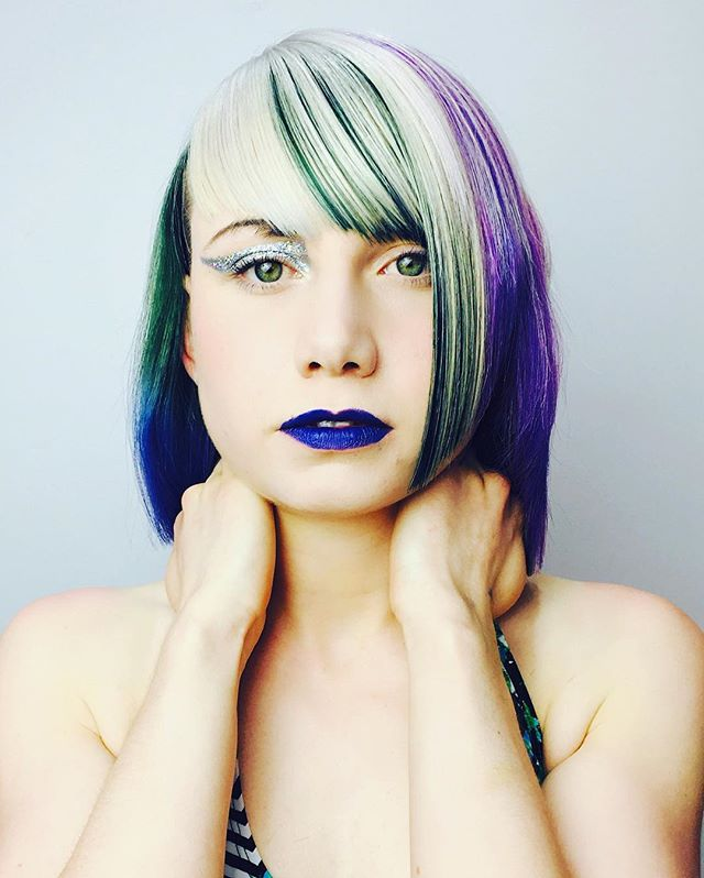 Makeup I did for a hair competition a few weeks ago. Silver eye and blue lips