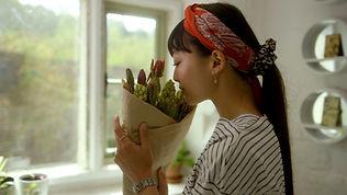 Product Promo - Tovi Sorga - Woman smelling flowers