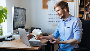 Earn money from home. Best Online jobs. Work from home on the internet. Man working on lap
