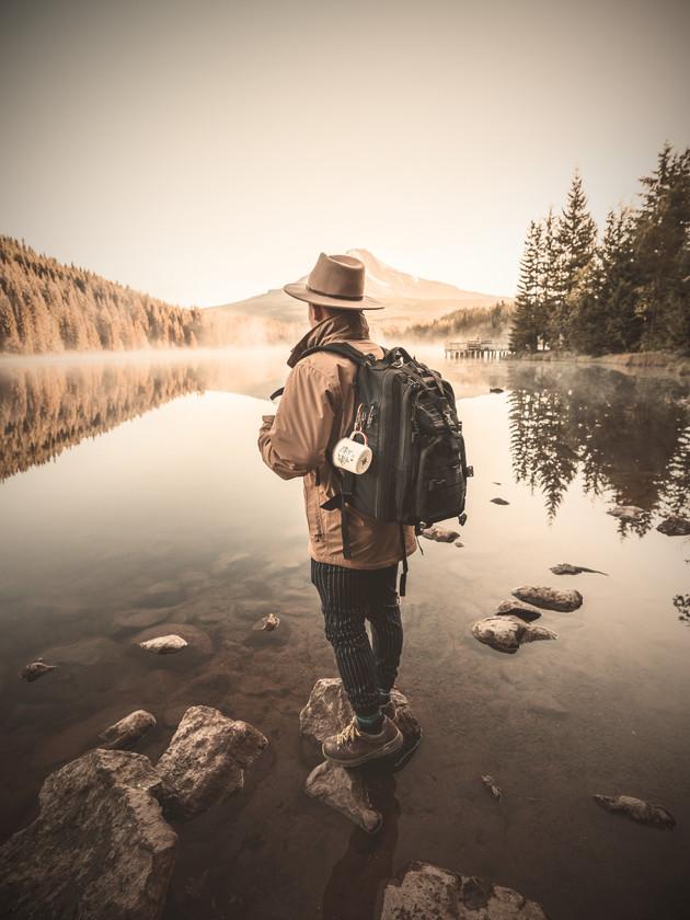 man-in-black-jacket-and-brown-hat-standi