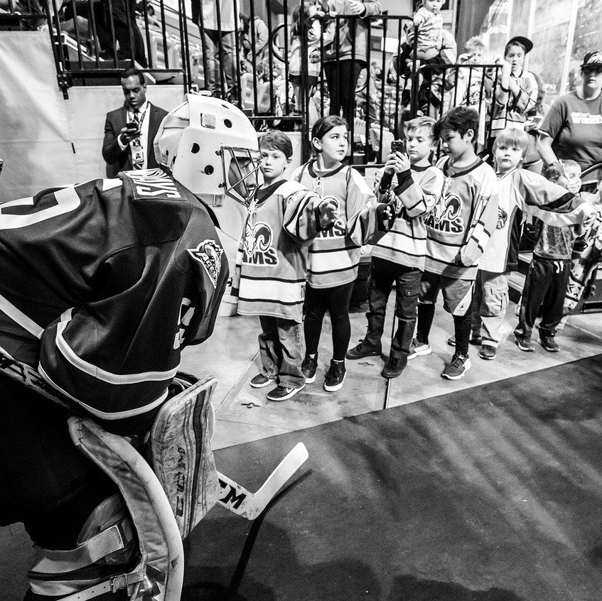 Anchorage native Steve Summerhays waits to take the ice as young fans surround him - 4.8.17