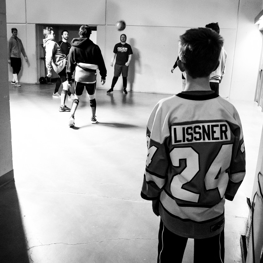 Young fan watches Alaska Aces players warm-up - 4.8.17