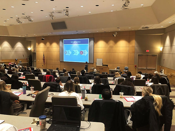 EBP Conference attendees looking at projection screen
