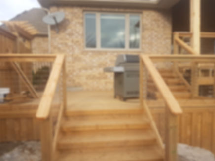 Custom pressure treated deck with stairs and wire railing