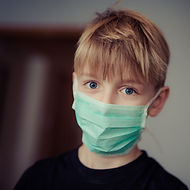 Canva - Boy Wearing Surgical Mask.jpg
