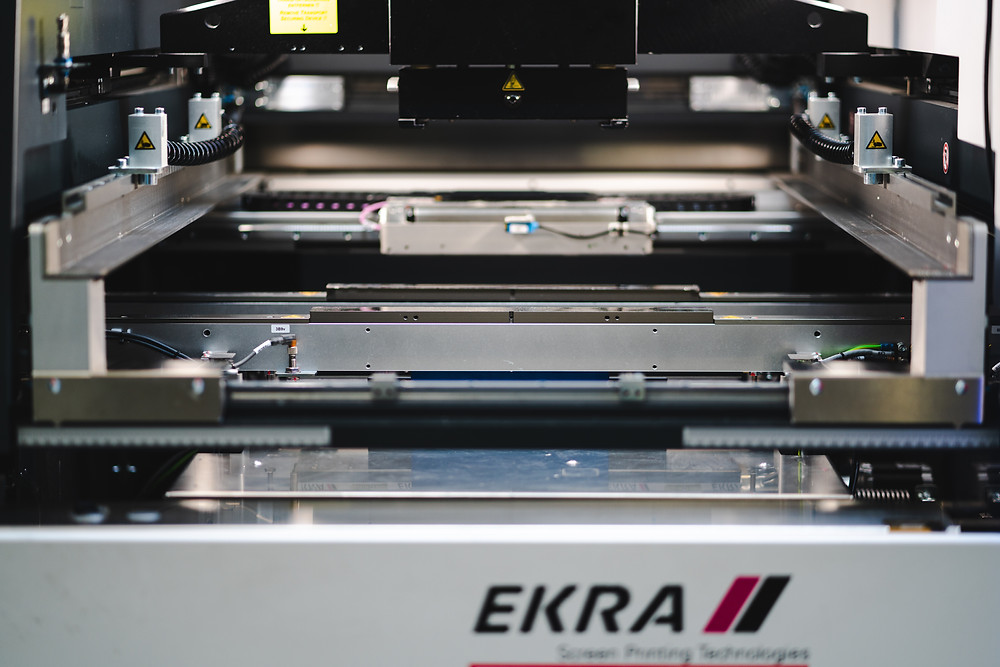 Ekra Screen Printer in an open position showing mounting table