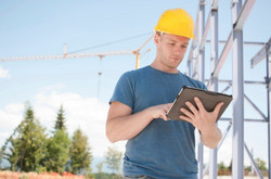 Worker-with-tablet_WirelessBlog