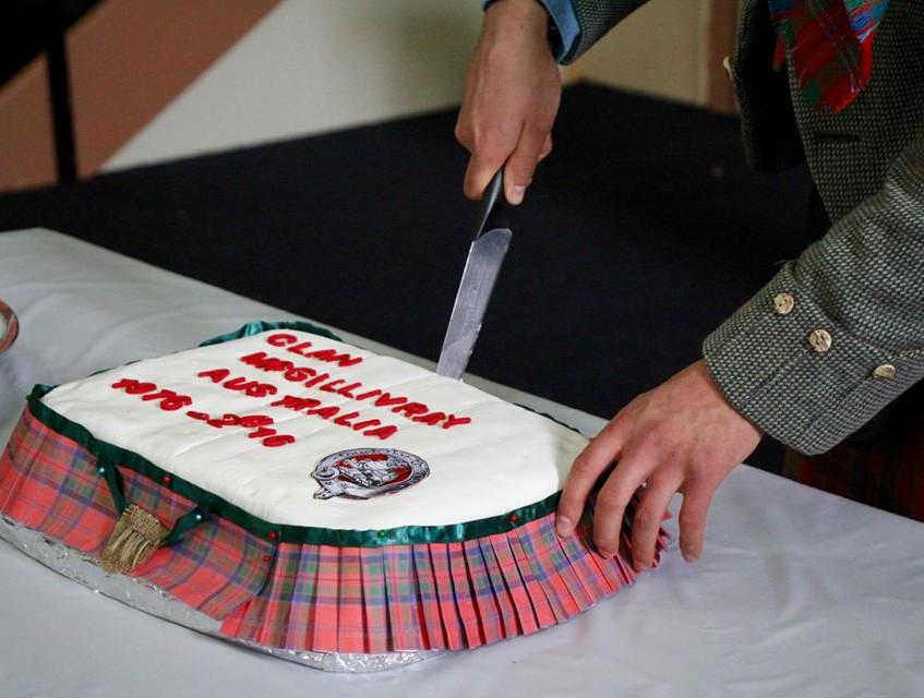 Iain cutting the anniversary cake, made by Jill Millsom of Bendigo.