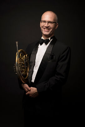 Karl Kramer smiling with his horn