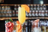 A mimoasa in front of cocktail garnishes