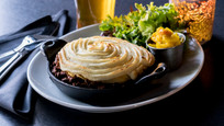 A tablescape with the Impossible Meat vegan Cottage Pie