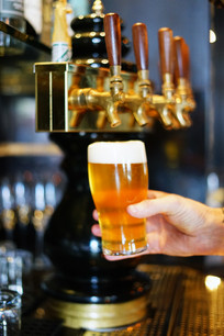 A closeup of a beer being poured from a tap at The Stalking Horse