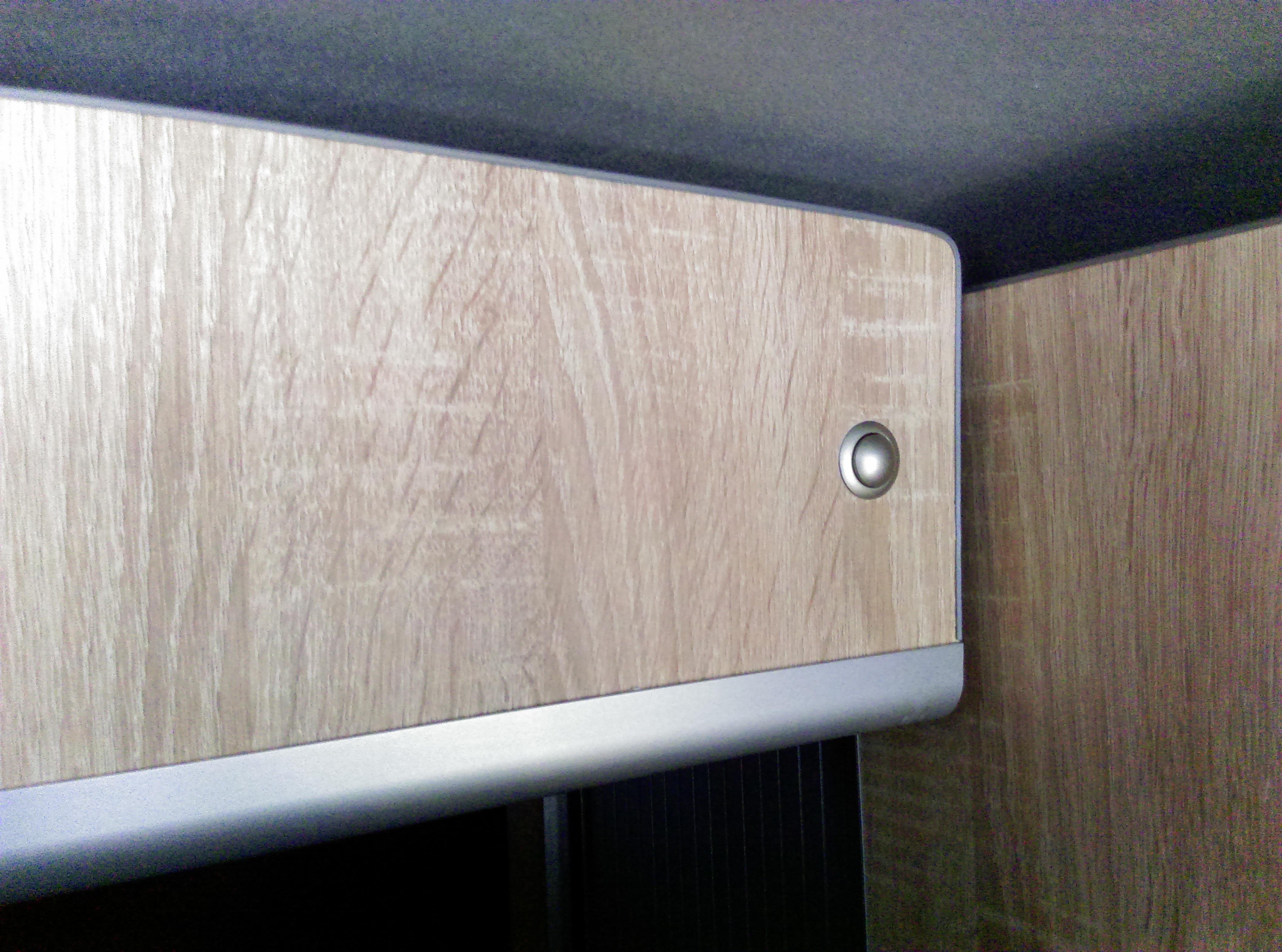 bouton d'ouverture rangement lit
