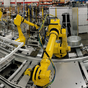 Robotic Assembly Cell for Automotive Cladding