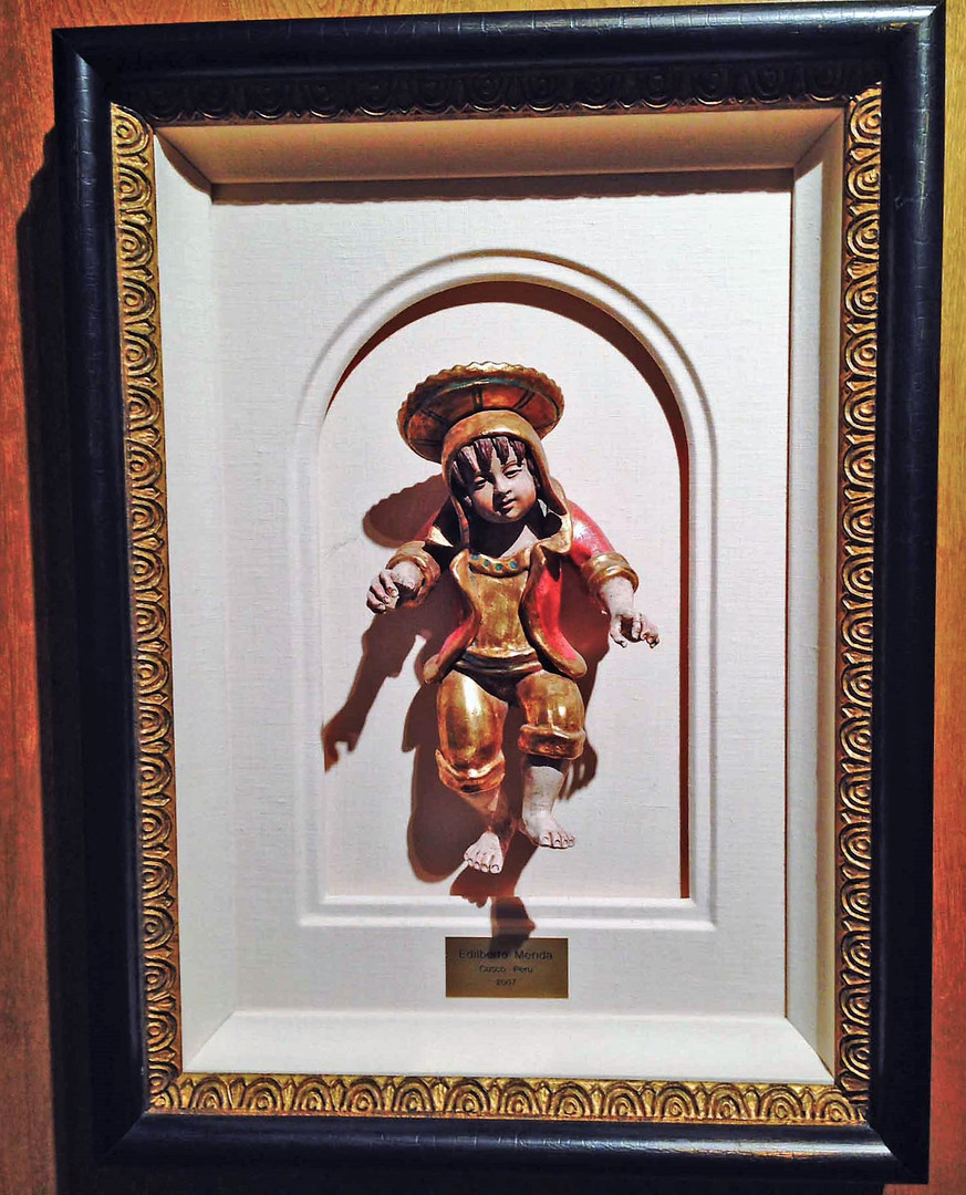 framing Peru boy with gold leaf so it wo
