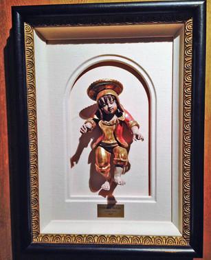 framing Peru boy with gold leaf so it wo