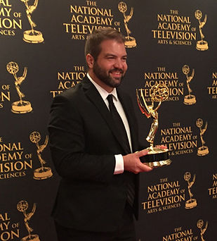 Matt Morton holding the Dinosaur 13 Emmy for Outstanding Science and Technology Programming in 2015