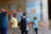Passeando pelas casas com afrescos de Pompéia