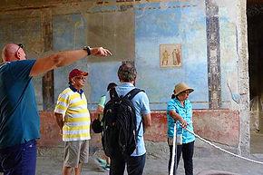 Passeio pelas casas com afrescos de Pompéia