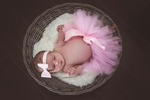 newborn baby girl tutu in basket