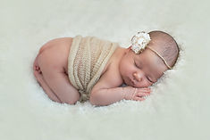 Newborn with headband, professional photographer
