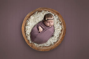 Newborn purple photoshoot professional photos