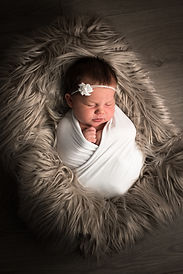 Newborn in basket fur