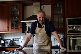 male portrait, portraiture, professional photo, kitchen, male, apron, professional portrait, social media photo, website photos