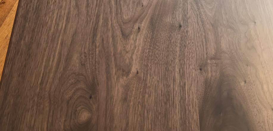 Walnut coffee table with pin legs