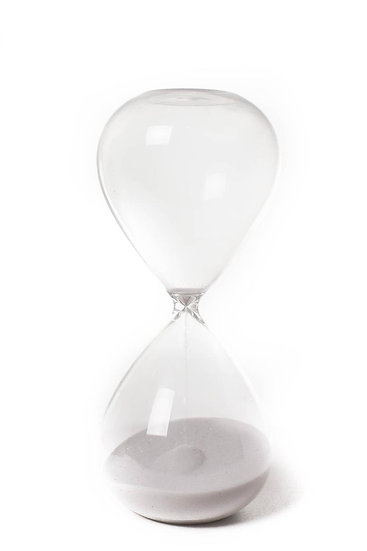 graceful hourglass with white beach sand